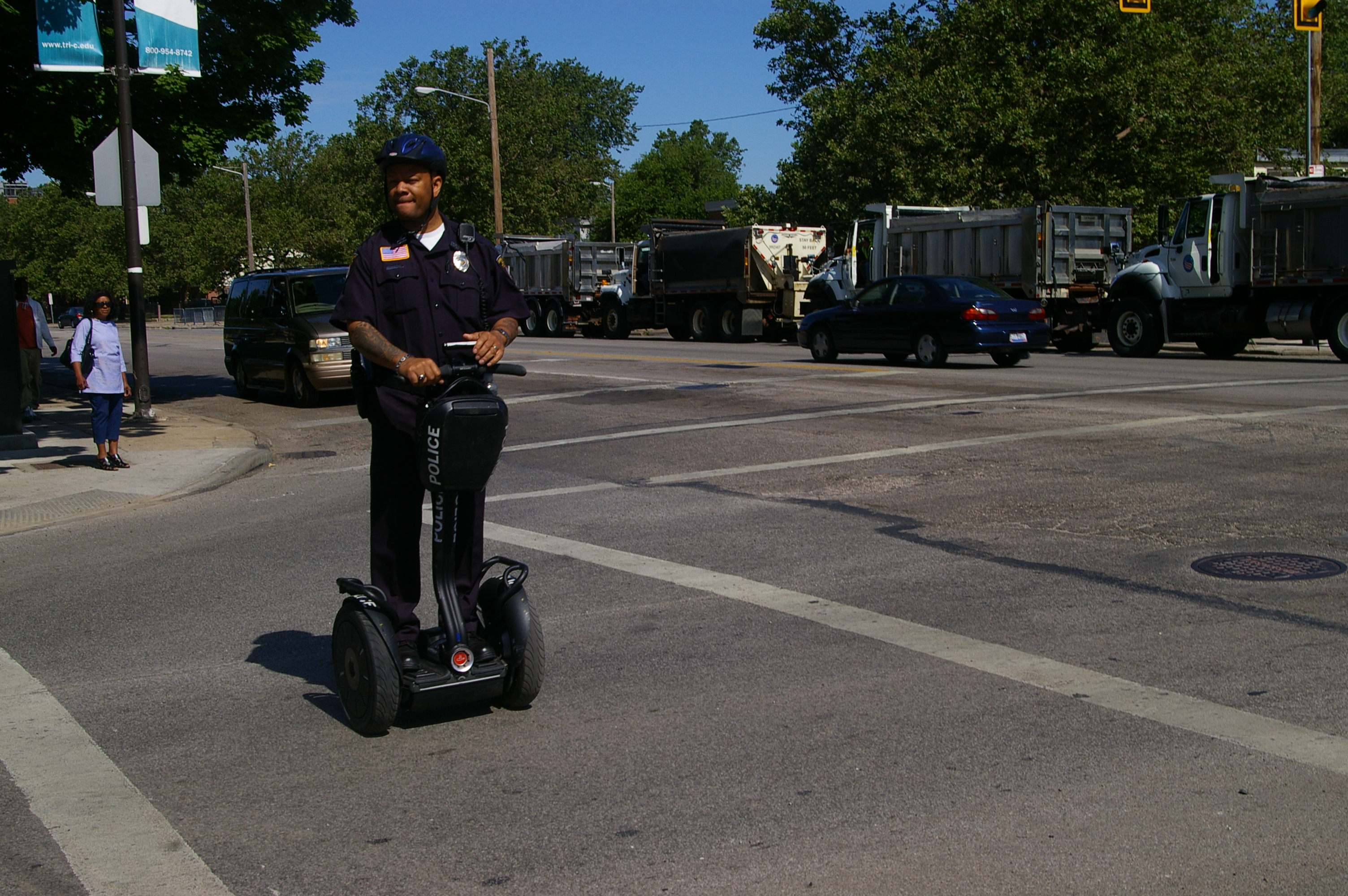 A policeman on a Segue monitors activity around the Presidential rally venue at the Tri-C Metro campus, from 2012