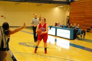 No. 40 Colleen Huberty attempts a 3-pointer while playing Lakeland Community College in Kirtland Feb. 20.