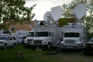 Dozens of satellite trucks are parked around the corner for the crime scene broadcasting live reports, images and feeds to network news, cable news channels and local affiliates around the world May 7 in Cleveland, Ohio.