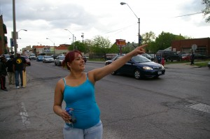 Janet Perez waves to honking cars along West 25th Street in West Cleveland May 7. The community who followed the kidnapping ordeal for the last 10 years felt a need to share their excitement.