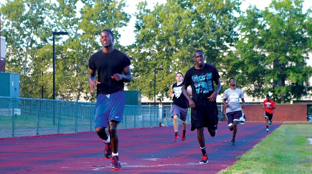 Players on the Tri-C Men's Basketball team may start their conference play in about 15 weeks, but conditioning starts now. Some players finish running laps on the track field at the Metro Campus Sept. 25. Photo by Bronson Peshlakai