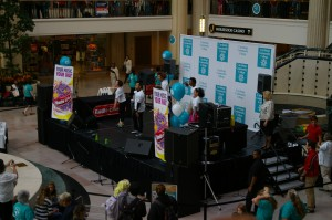 Dancers on stage spark a massive flash mob at Tower City Sept. 23.