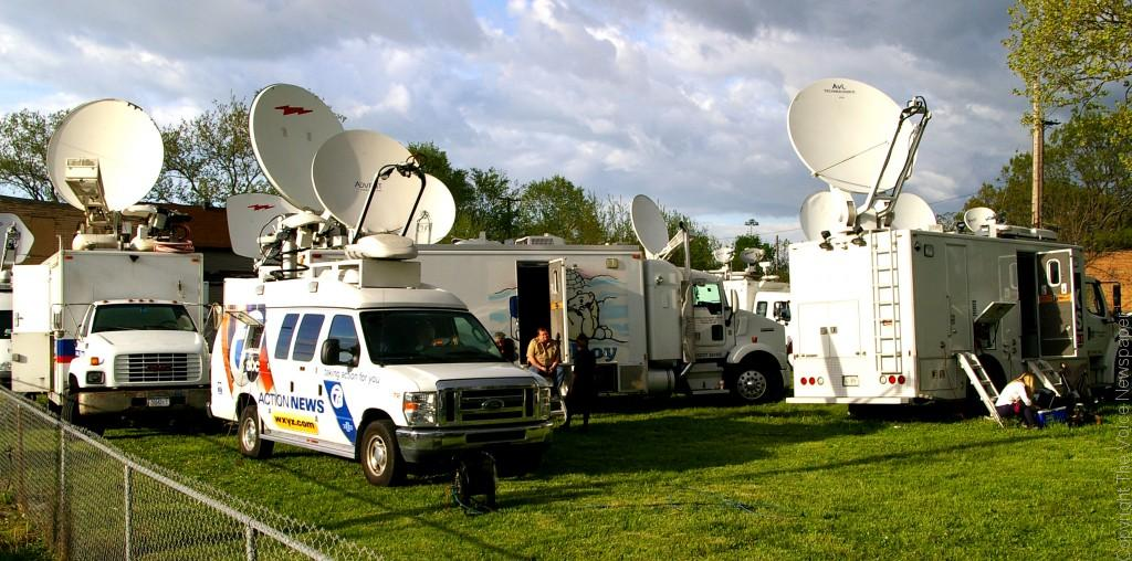 Dozens of satellite trucks park in an empty lot feeding news reports of the discovery of three young women who were held captive for more than a decade on Seymour Avenue on Cleveland's West side on May 6, 2013. Photos by Bronson Peshlakai