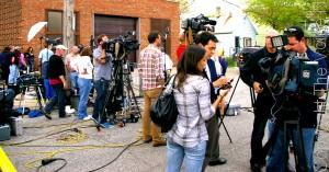 National and local TV journalists squeezed in on Seymour Avenue down the street from where police investigators were getting a first look at Ariel Castro's residence, the convicted kidnapper of Amanda Berry, Gina DeJesus and Michelle Knight.