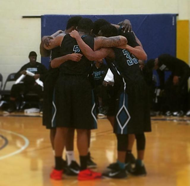 Conference tournament Photo.. The Challengers huddle up during a game against LCCC. Photo by Mitchel Guy