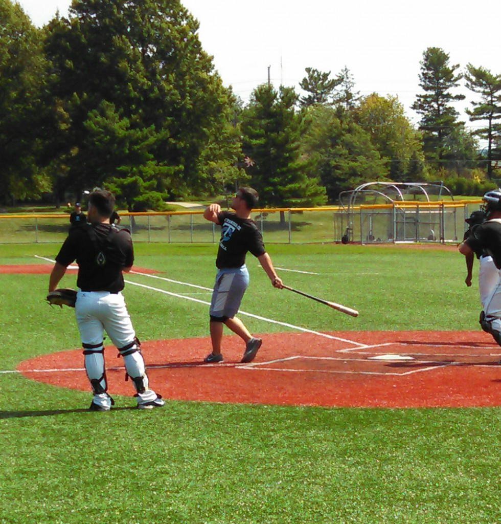 Players participate in batting drills during practice. Photo by Robert Fenbers